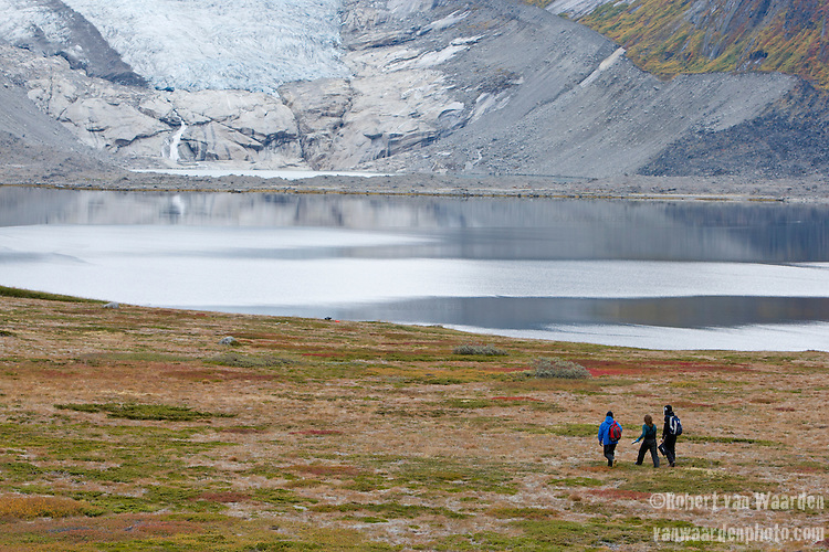 Three students in the Southern Greenland landscape in Tasermiut Fjord. The students are part of the Cape Farewell Youth Expedition that was organized by the British Council of Canada. In the background, a receding glacier.
