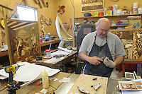 NWA Democrat-Gazette/ANDY SHUPE<br /> Tommy Smith of Springdale works Wednesday, Nov. 4, 2015, in his wood shop at his home on Beaver Lake.