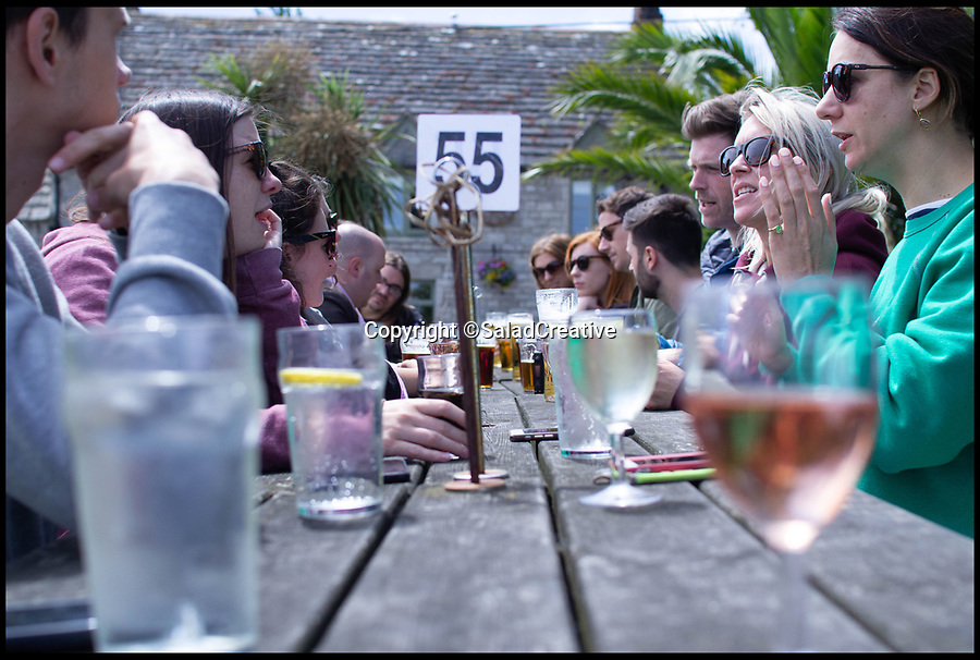 BNPS.co.uk (01202 558833)<br /> Pic:     SaladCreative/BNPS<br /> <br /> June 2019 - Banks Arms pub lunch in Studland, Dorset.<br /> <br /> Britain's 'best boss' has once again gone out of her way to treat her staff - by throwing a summer party.<br /> <br /> Arabella Lewis-Smith, 43, earned the title after taking her 20 staff on an all expenses paid trip to Madrid for a three day Christmas party, covering the £5,000 bill.<br /> <br /> Now, the founder of Salad Creative, a marketing agency, has further endeared herself to them by putting on a special day out on the idyllic Dorset coast.<br /> <br /> Things kicked off with a lively pub lunch, then the group meandered their way down to Knoll Beach in Studland for an afternoon picnic.