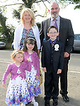 Kevin McKeever who received first holy communion at the church of SS Peter and Paul Walshestown pictured with parents Finton and paula and sisters Kailey and Lily. Photo:Colin Bell/pressphotos.ie