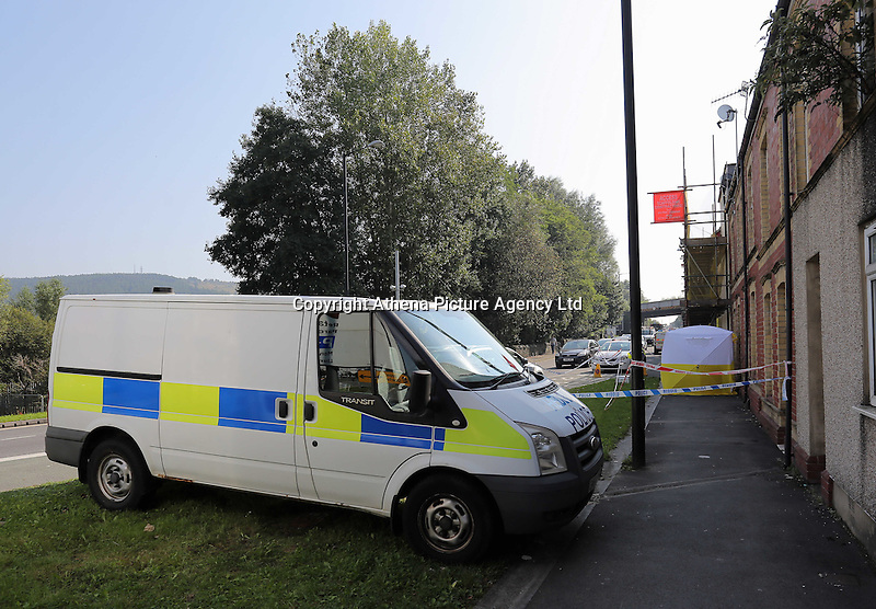 Pictured: A police cordon and a forensics tent outside the house where the body of Alison Jane Farr-Davies was discovered in Swanse, Wales, UK Wednesday 14 September 2016<br /> Re: A man has been arrested on suspicion of murder following the death of a woman in the Hafod area of Swansea.<br /> The body of 42 year old Alison Jane Farr-Davies was found dead at a home in Neath Road, at about 13:35 on Tuesday.<br /> Police said officers responded to several calls from residents who reported seeing a man in the road between 13:00 and 14:00, and appealed for witnesses to come forward.<br /> The arrested man, 37, remains in custody at Swansea Central station.<br /> Acting Det Supt Kath Pritchard thanked people who stopped at the scene to help on Tuesday.