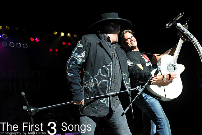 Eddie Montgomery, left, and Troy Gentry of Montgomery Gentry perform at the Blossom Music Center in Cleveland, Ohio on May 20, 2010.