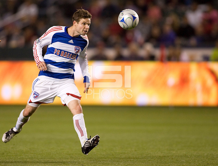 FC Dallas defender Drew Moor eyes the ball. The Chivas USA defeated FC Dallas 2-0 at Home Depot Center stadium in Carson, California on Saturday April 25, 2009.   .