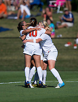 Makenzy Doniak (9) of Virginia celebrates her goal with teammates during the game at Klockner Stadium in Charlottesville, VA.  Virginia defeated Duke, 1-0.