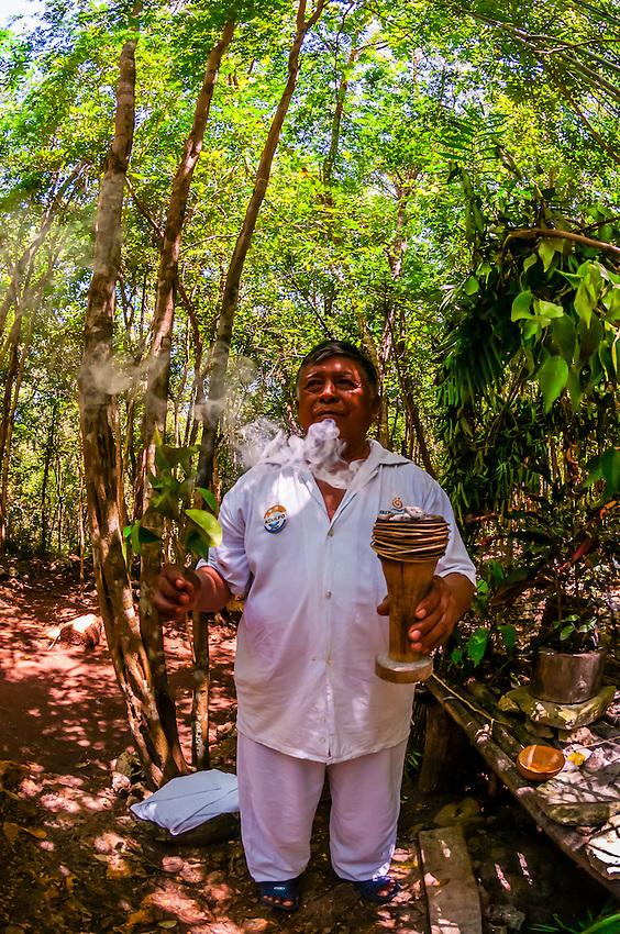 A Mayan shaman performing a purification ceremony in the jungle, near Riviera Maya, Mexico