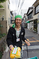 "A man sells citrus fruit on the street, Yanaka, Tokyo, Japan, April 19, 2012. Yanaka is part of Tokyo's ""shitamachi"" historic working class wards. Recently it has become popular with Japanese and foreign tourists for its many temples, shops, restaurants and relaxed atmosphere."