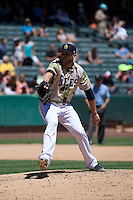 Justin Thomas (10) Salt Lake Bees delivers a pitch to the plate against the Fresno Grizzlies at Smith's Ballpark on May 26, 2014 in Salt Lake City, Utah.  (Stephen Smith/Four Seam Images)