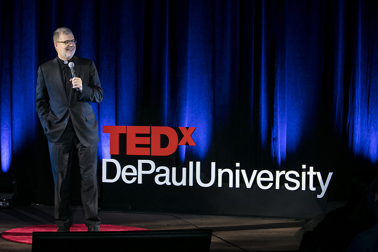 """The Rev. Dennis H. Holtschneider, C.M., president of DePaul University, offers remarks at TEDxDePaulUniversity Tuesday, April 18, 2017, in the Lincoln Park Student Center. TEDxDePaulUniversity is an independently run, self-organized event. Through the theme """"Courage to Connect"""" 10 speakers from across the DePaul community challenged thoughts and inspired ideas through a series of engaging talks and presentations. (DePaul University/Jeff Carrion)"""