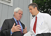 """Washington, DC - May 16, 2009 -- Former Speaker of the House Newt Gingrich (Republican of Georgia), left, and U.S. Secretary of Education Arne Duncan, right, share some private thoughts prior to the """"Close the Gap: Education Equality Day"""" on the White House Ellipse in Washington, D.C. on Saturday, May 16, 2009..Credit: Ron Sachs / CNP.(RESTRICTION: NO New York or New Jersey Newspapers or newspapers within a 75 mile radius of New York City)"""