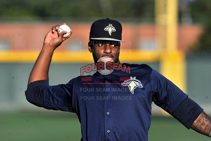 Center fielder Ivan Wilson (18) of the Columbia Fireflies warms up before a game against the Greenville Drive on Saturday, April 23, 2016, at Fluor Field at the West End in Greenville, South Carolina. Columbia won, 7-3. (Tom Priddy/Four Seam Images)