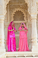Indian women wearing traditional sari at The Jaswant Thada an architectural landmark found in Jodhpur. It is a white marble memorial built by Sardar Singh in 1899 in memory of Maharja Jaswant Singh II. The monument, in its entirety, is built out of intricately carved sheets of marble.