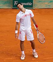 Novak DJOKOVIC (SRB) against Fernando VERDASCO (ESP) in the semi-finals. Fernando Verdasco beat Novak Djokovic 6-2 6-2..International Tennis - 2010 ATP World Tour - Masters 1000 - Monte-Carlo Rolex Masters - Monte-Carlo Country Club - Alpes-Maritimes - France..© AMN Images, Barry House, 20-22 Worple Road, London, SW19 4DH.Tel -  + 44 20 8947 0100.Fax - + 44 20 8947 0117