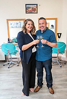 "Pictured: Richard Davies (R) and  Faye Stevenson who won the £1 EuroMillions in Talgarth near Brecon, Wales, UK.<br /> Re: A Brecon hairdresser whose car broke down on his way to claim his £1 million EuroMillions UK Millionaire Maker prize, has bought AA membership as one of his first post-win purchases.<br /> Time was also of the essence when winner Richard Davies, who has owned Chop and Change salon in Talgarth for 14 years, dashed out to buy his EuroMillions ticket with just four minutes to spare before the draw closed on Friday, 1 June. <br /> And now after 10 years as a couple, he and partner Faye Stevenson are planning on splashing out on their first holiday together, after matching one of that night's EuroMillions UK Millionaire Maker codes to scoop the life-changing amount. <br /> Nurse Faye, and Richard, 41, both have hectic work schedules. He said: ""I had forgotten to buy my ticket and, as ever, Friday had been frantic in the salon!"