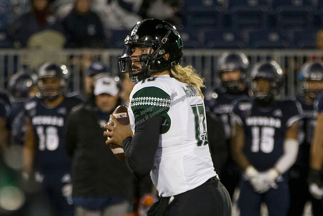 Hawaii quarterback Cole McDonald (13) rolls out against Nevada in the first half of an NCAA college football game in Reno, Nev. Saturday, Sept. 28, 2019. (AP Photo/Tom R. Smedes)