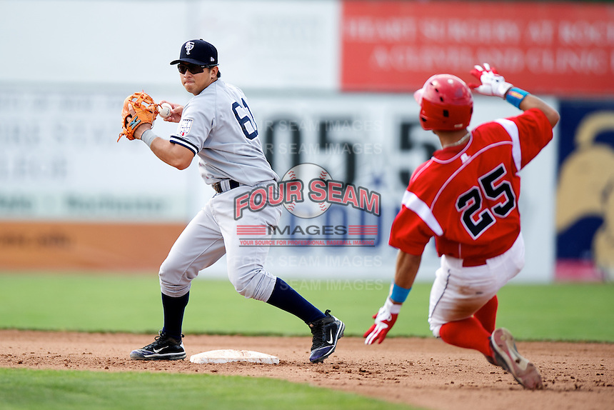 Staten Island Yankees Fu-Lin Kuo #61 attempts to turn a double play as Gary Apelian #25 slides in during a game against the Batavia Muckdogs at Dwyer Stadium on July 29, 2012 in Batavia, New York.  Batavia defeated Staten Island 10-2.  (Mike Janes/Four Seam Images)