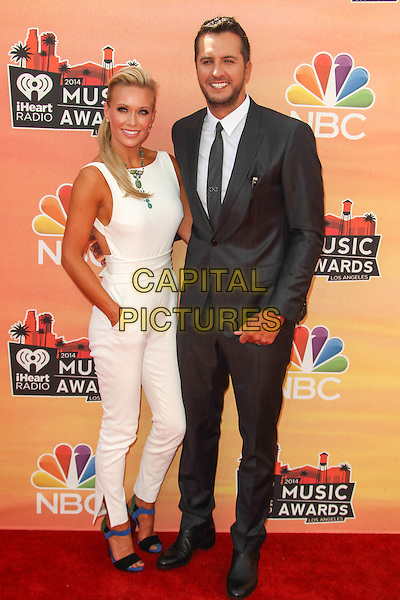 LOS ANGELES, CA - MAY 1: Caroline Bryan, Luke Bryan attending the 2014 iHeartRadio Music Awards held at the Shrine Auditorium in Los Angeles, California on May 1st, 2014.  <br /> CAP/MPI/RTNUPA<br /> &copy;RTNUPA/MediaPunch/Capital Pictures