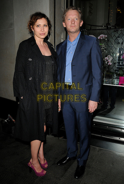 GUEST & DOUGLAS HENSHALL.The Jennifer Hudson new album launch party, The Ivy Club, London, England..April 20th, 2011.full length black coat jacket dress tassels fringed purple pink shoes blue suit shirt .CAP/CAN.©Can Nguyen/Capital Pictures.