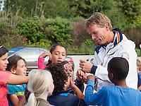 13-09-12, Netherlands, Amsterdam, Tennis, Daviscup Netherlands-Swiss, Streettennis, , captain Jan Siemerink signing autographs.