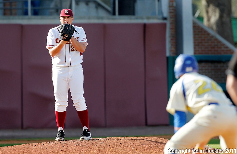 TALLAHASSEE, FL 2/26/11-FSU-HOFSTRA BASE11 CH-Florida State pitcher Brian Busch keeps an eye on Hofstra's Danny Poma as he leads off at first Saturday at Dick Howser Stadium in Tallahassee. The Seminoles beat the Pride 16-3...COLIN HACKLEY PHOTO