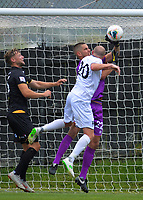 United's Bill Robertson pressures keeper Keegan Smith during the ISPS Handa Premiership football match between Team Wellington and Hawkes Bay United at David Farrington Park in Wellington, New Zealand on Sunday, 12 January 2020. Photo: Dave Lintott / lintottphoto.co.nz