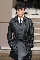 Chen Kun arrives for the Burberry Prosum menswear AW14 as part of London Collections Men, Kensington Gardens, London.08/01/2014 Picture by: Steve Vas / Featureflash