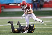 Arkansas Democrat-Gazette/THOMAS METTHE -- 11/29/2019 --<br /> Missouri linebacker Nick Bolton (32) trips up Arkansas quarterback Jack Lindsey (18) during the fourth quarter of the Razorbacks' 24-14 loss to Missouri on Friday, Nov. 29, 2019, at War Memorial Stadium in Little Rock.