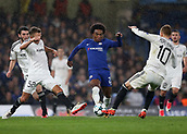 12th September 2017, Stamford Bridge, London, England; UEFA Champions League Group stage, Chelsea versus Qarabag FK; Willian of Chelsea being intercepted by Jakub Rzezniczak of Qarabag FK and Pedro Henrique of Qarabag FK