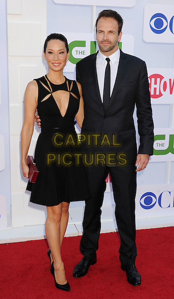 Lucy Liu, Jonny Lee Miller .CBS, CW, Showtime 2012 Summer TCA Party held at The Beverly Hilton Hotel, Beverly Hills, California, USA..July 29th, 2012.full length dress black cut out away low cut neckline cleavage sleeveless maroon burgundy clutch bag suit stubble facial hair.CAP/ROT/TM.©Tony Michaels/Roth Stock/Capital Pictures