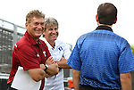 09 September 2014: Temple head coach David MacWilliams (left) and Duke head coach John Kerr (center) with Fourth Official Jeremy Smith (right). The Duke University Blue Devils hosted the Temple University Owls at Koskinen Stadium in Durham, North Carolina in a 2014 NCAA Division I Men's Soccer match. Duke won the game 3-1.