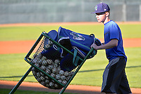 The baseball cart is rolled off the field by a member of the grounds crew when the Ogden Raptors faced the Orem Owlz in Pioneer League play at Lindquist Field on August 28, 2013 in Ogden Utah.  (Stephen Smith/Four Seam Images)