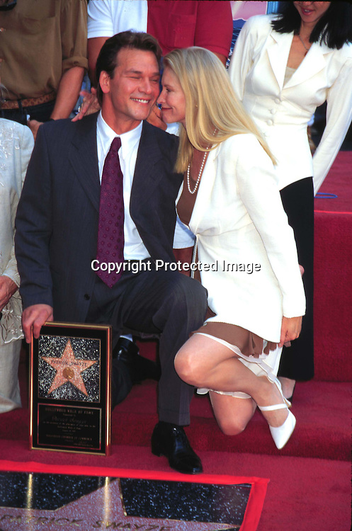 "©KATHY HUTCHINS/HUTCHINS.8/18/97 "" PATRICK SWAYZE STAR ON HOLLYWOOD WALK FOF FAME"".PATRICK SWAYZE & WIFE LISA NEIMI"
