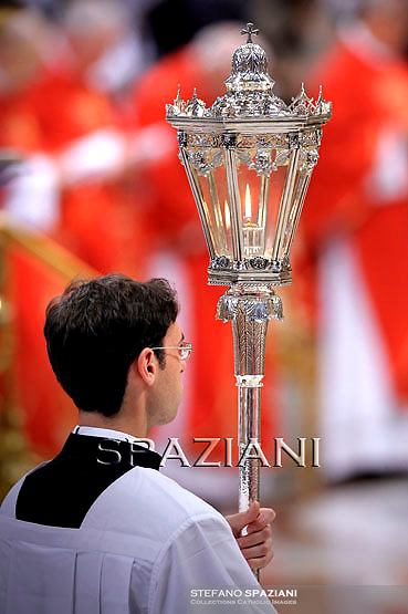 candelabrum priests;Pope Benedict XVI celebrates the Pentecost Mass in St. Peter's Basilica at the Vatican on  June 12, 2011