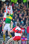 David Moran Kerry in action against Fergal Doherty Derry in round Two of the National Football league at Fitzgerald Stadium, Killarney on Sunday the 9th of February.