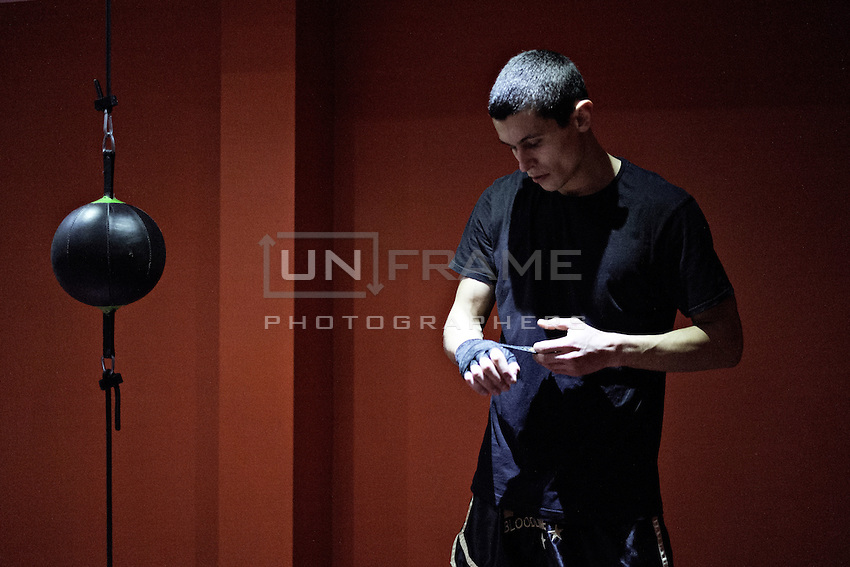 Przemek Kierpacz, a professional Muay Thai boxer and also an advocate for Roma Support Group, prepares for training in his local gym. London, UK, 9th March 2015.