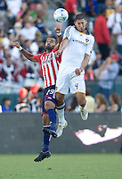 LA Galaxy defender Omar Gonzalez and Chivas USA forward Maicon Santos battle. The LA Galaxy and Chivas USA played to 2-2 draw during a MLS Western Conference playoff game at Home Depot Center stadium in Carson, California on Sunday November 1, 2009...