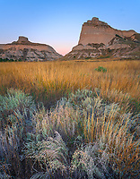 Scotts Bluff National Monument, Nebraska:<br /> Scotts Bluff rises above prairie grasses at dawn.
