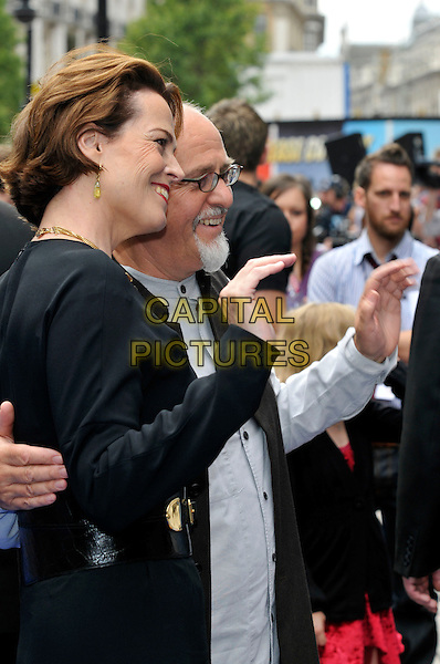 "SIGOURNEY WEAVER & PETER GABRIEL.UK Premiere of ""Wall-E"" at the Empire, Leicester Square, London, England. .July 13th, 2008.half length dress belt profile hand waving glasses goatee facial hair .CAP/PL.©Phil Loftus/Capital Pictures."