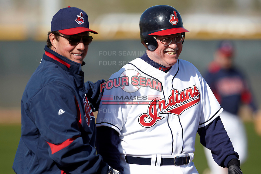 Former major league catcher Kevin Rhomberg (left) talks with a member from the Cleveland Indians Fantasy Camp during a game at Goodyear Training Complex on January 18, 2012 in Goodyear, Arizona.  (Mike Janes/Four Seam Images)