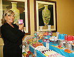 "Guiding Light's Kim Zimmer ""Reva"" holds up one of the many soaps at a vendor shop at the Young Women's Breast Cancer Foundation event - Reach to Recovery - ""Spring into Shape!"" Luncheon and Fashion Show on April 6, 2008 at Embassy Suites, Coraopolis, Pennsylvania. The event also included a Chinese Auction and an autograph session with the Guiding Light actors. (Photo by Sue Coflin/Max Photos)"