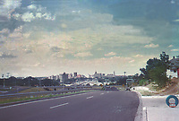 Vintage 1960s view of downtown Austin skyline looking north to the Capitol and UT Tower from Riverside Drive overpass over Interstate I-35 in South Austin, Texas.