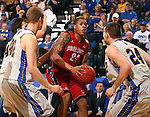 BROOKINGS, SD - MARCH 1:  Karim Rowson #24 from the University of South Dakota takes the ball into traffic between Jordan Dykstra #42, Marcus Heemstra #32, Brayden Carlson #12, and Zach Horstman #24 from South Dakota State University in the first half or their game Saturday afternoon at Frost Arena in Brookings. (Photo by Dave Eggen/Inertia)