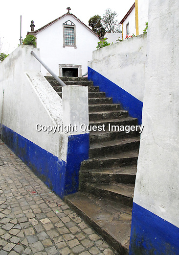 Obidos, in central Portugal, is a walled medieval village with narrow cobblestones lanes and an old roman aqueduct dating back to the 4th or 5th century.<br /> Photo by Mike Rynearson/Quest Imagery