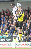Bolton Wanderers Sammy Ameobi in action with Burton Albion's Tom Naylor<br /> <br /> Photographer Mick Walker/CameraSport<br /> <br /> The EFL Sky Bet Championship - Burton Albion v Bolton Wanderers - Saturday 28th April 2018 - Pirelli Stadium - Burton upon Trent<br /> <br /> World Copyright &copy; 2018 CameraSport. All rights reserved. 43 Linden Ave. Countesthorpe. Leicester. England. LE8 5PG - Tel: +44 (0) 116 277 4147 - admin@camerasport.com - www.camerasport.com