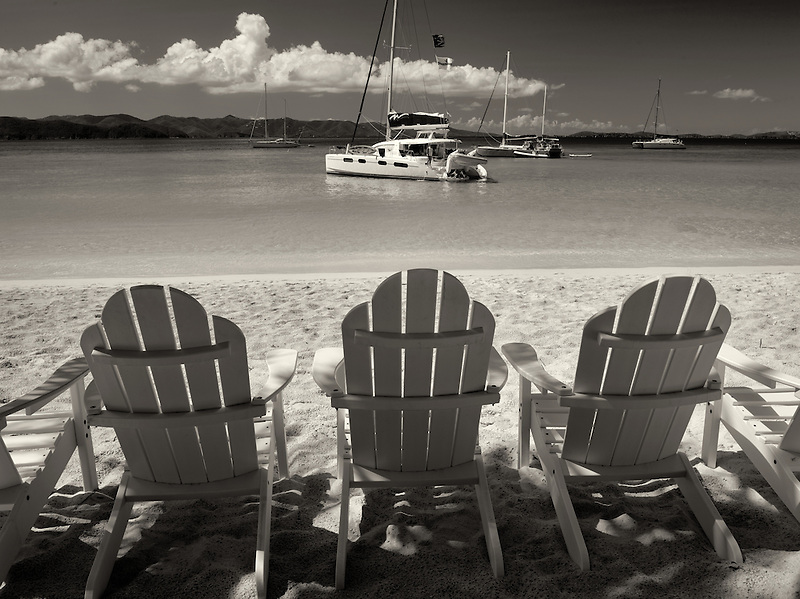Adirondack chair boats and beach. Jost Van Dyke. British Virgin Islands