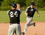 OXFORD, CT-062217JS23- Oakville's Ryan Dunfee (11) gets the stop sign from assistant coach Tim Belcher during their American Legion Zone 5 game against Oxford Post 174 Thursday at Oxford High School. Jim Shannon Republican-American