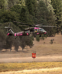 -Rim Fire- National Guard Black Hawks gets water out of a small pond in Kasabaum Meadow 5 miles east of Groveland.