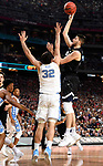 GLENDALE, AZ - APRIL 03: Killian Tillie #33 of the Gonzaga Bulldogs shoots a jumper over Luke Maye #32 of the North Carolina Tar Heels during the 2017 NCAA Men's Final Four National Championship game at University of Phoenix Stadium on April 3, 2017 in Glendale, Arizona.  (Photo by Jamie Schwaberow/NCAA Photos via Getty Images)