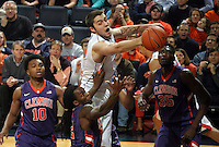 Virginia forward/center Mike Tobey (10) reaches for the loose ball above Clemson defenders dduring an ACC basketball game Jan. 13, 2015 in Charlottesville, VA Virginia won 65-42.