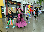 Children from Ennis Holy Family school march in procession to the Market before the annual  Clare Champion Halloween Party. Photograph by John Kelly.