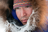 Portrait of Robert Nelson of Kotzebue shortly after his arrival in Shageluk checkpoint during Iditarod 2009